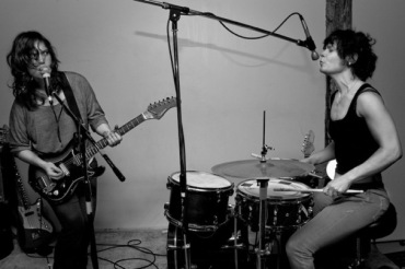 Sarah Register on guitar and Andrya Ambro on drums